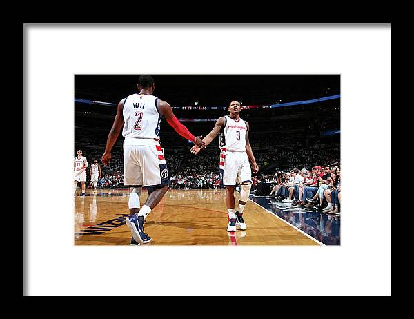 Playoffs Framed Print featuring the photograph John Wall and Bradley Beal by Ned Dishman
