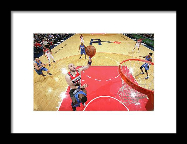 Nba Pro Basketball Framed Print featuring the photograph Marcin Gortat by Ned Dishman
