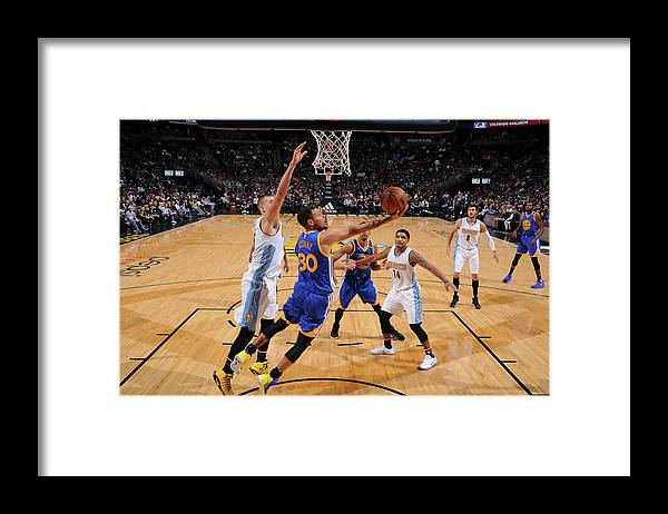 Nba Pro Basketball Framed Print featuring the photograph Stephen Curry by Garrett Ellwood