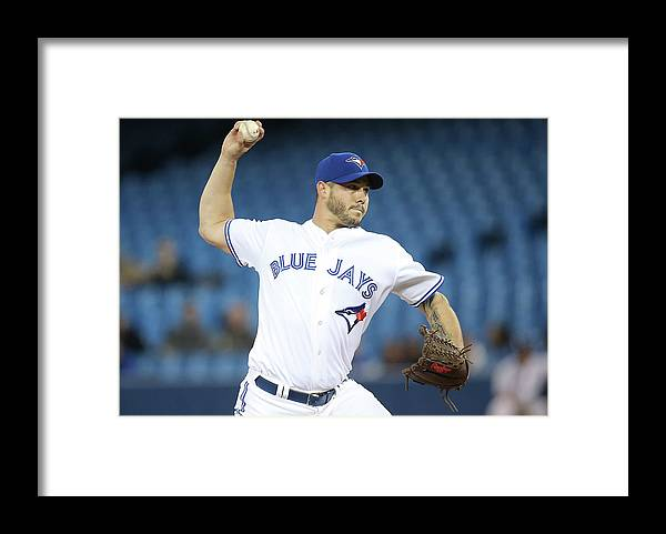 Second Inning Framed Print featuring the photograph Jay Rogers by Tom Szczerbowski