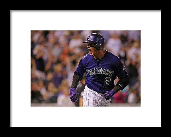 Game Two Framed Print featuring the photograph Troy Tulowitzki by Doug Pensinger