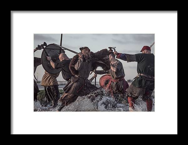 Water's Edge Framed Print featuring the photograph A Hoard Of Weapon Wielding Viking Warriors Fighting In A Battlefield Scene In The Sea by Lorado