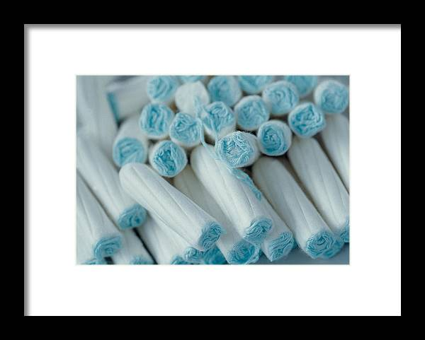 Tampon Framed Print featuring the photograph A pile of tampons by Image Source