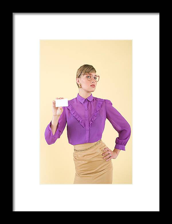People Framed Print featuring the photograph A woman holding a business card by Image Source