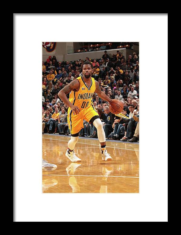 Nba Pro Basketball Framed Print featuring the photograph Aaron Brooks by Ron Hoskins