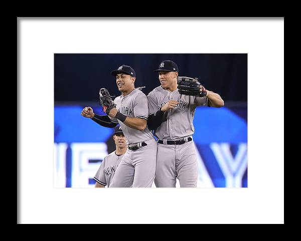 People Framed Print featuring the photograph Aaron Judge and Giancarlo Stanton by Tom Szczerbowski
