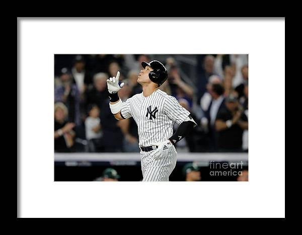 Playoffs Framed Print featuring the photograph Aaron Judge And Liam Hendriks by Elsa