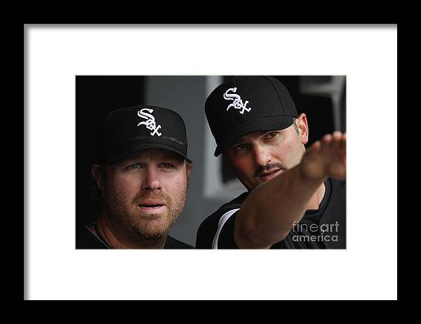 People Framed Print featuring the photograph Adam Dunn and Paul Konerko by Jonathan Daniel