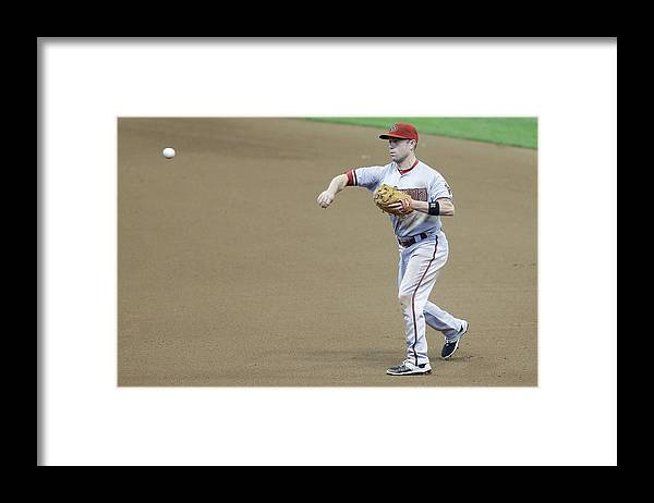 People Framed Print featuring the photograph Adam Lind and Chris Owings by Mike Mcginnis