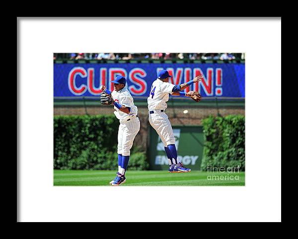 People Framed Print featuring the photograph Addison Russell and Starlin Castro by David Banks