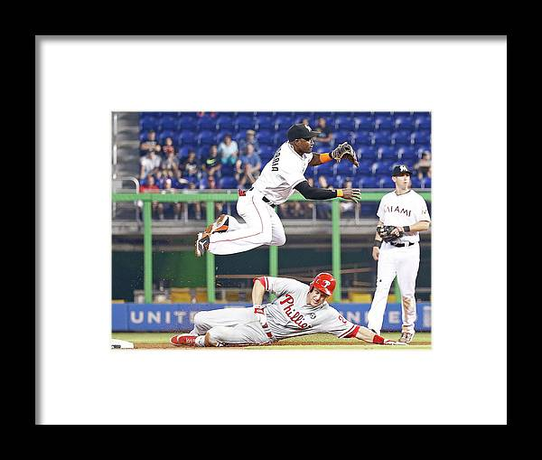 Double Play Framed Print featuring the photograph Adeiny Hechavarria And Chase Utley by Rob Foldy