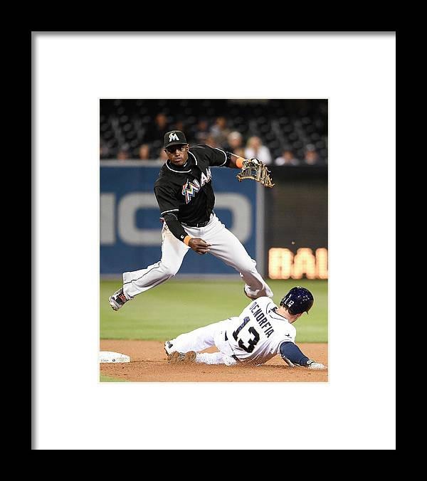 Double Play Framed Print featuring the photograph Adeiny Hechavarria and Chris Denorfia by Denis Poroy