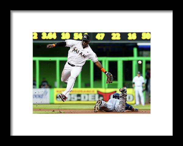 American League Baseball Framed Print featuring the photograph Adeiny Hechavarria and Jean Segura by Alex Trautwig