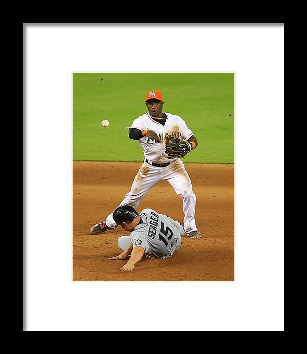 Double Play Framed Print featuring the photograph Adeiny Hechavarria And Kyle Seager by Mike Ehrmann