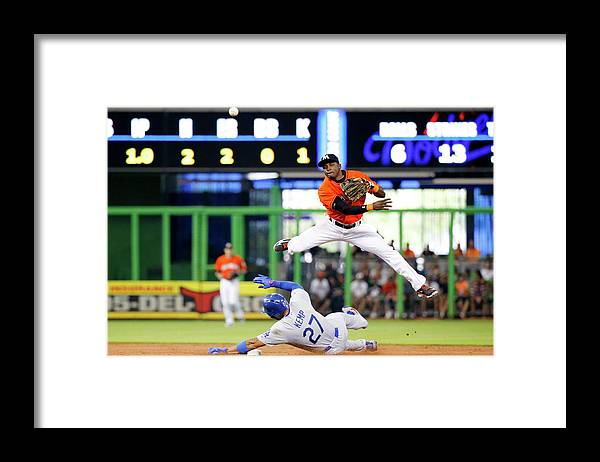 Double Play Framed Print featuring the photograph Adeiny Hechavarria and Matt Kemp by Rob Foldy