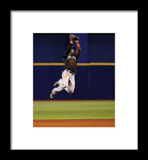 American League Baseball Framed Print featuring the photograph Adeiny Hechavarria and Yunel Escobar by Mike Carlson