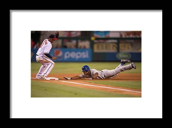 Adrian Beltre Framed Print featuring the photograph Adrian Beltre And Yunel Escobar by Matt Brown