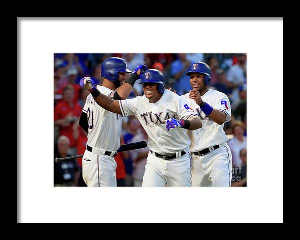Adrian Beltre Framed Print featuring the photograph Adrian Beltre, Elvis Andrus, and Nomar Mazara by Tom Pennington