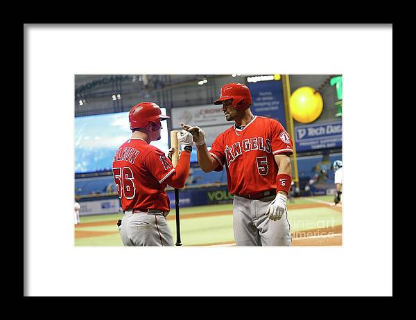 Ninth Inning Framed Print featuring the photograph Albert Pujols and Kole Calhoun by Brian Blanco