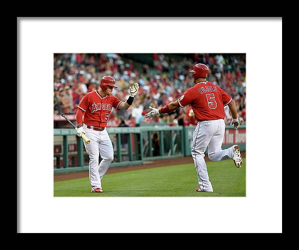 People Framed Print featuring the photograph Albert Pujols and Kole Calhoun by Harry How
