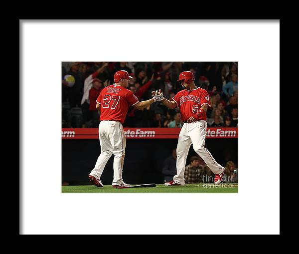 People Framed Print featuring the photograph Albert Pujols, Andrelton Simmons, and Mike Trout by Victor Decolongon