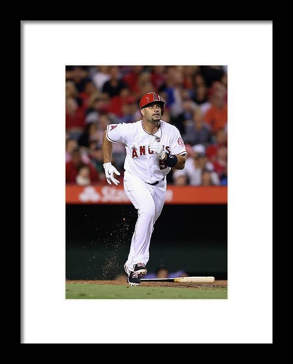 American League Baseball Framed Print featuring the photograph Albert Pujols by Jeff Gross