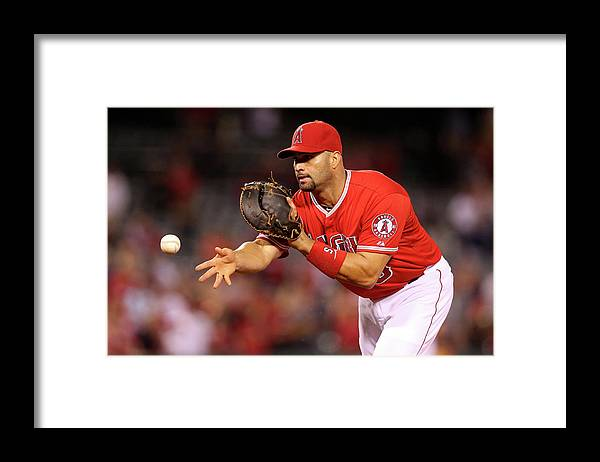 American League Baseball Framed Print featuring the photograph Albert Pujols, Nick Franklin, and Cam Bedrosian by Stephen Dunn