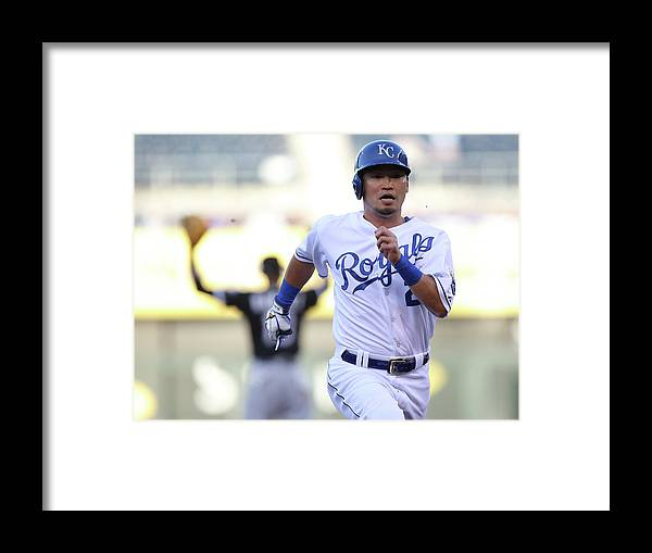 American League Baseball Framed Print featuring the photograph Alcides Escobar by Ed Zurga