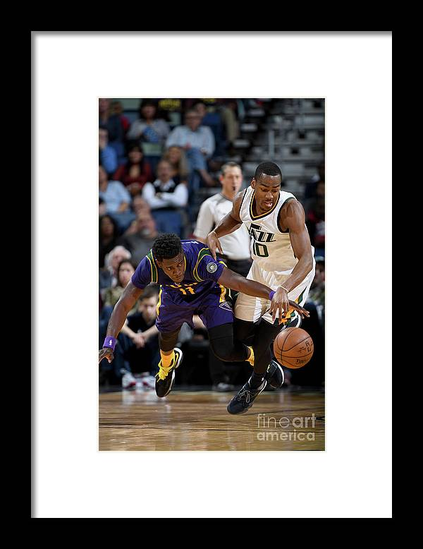 Smoothie King Center Framed Print featuring the photograph Alec Burks and Jrue Holiday by Garrett Ellwood