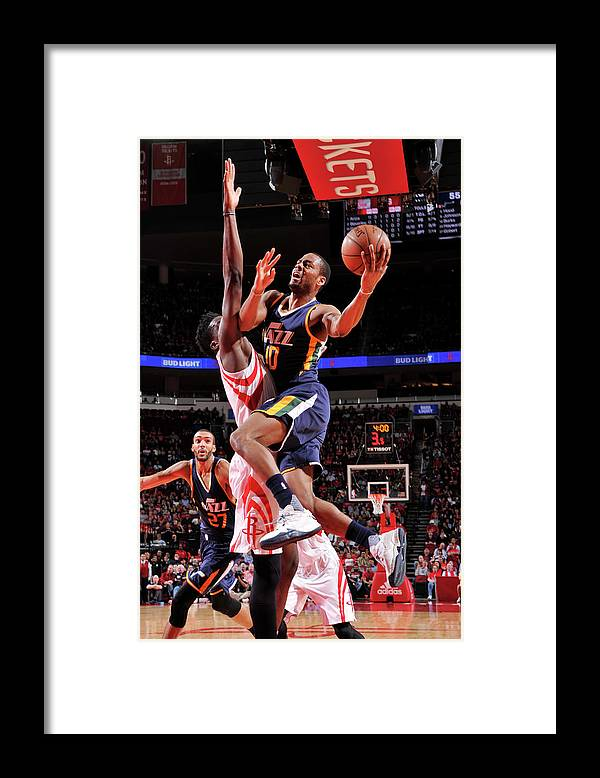 Nba Pro Basketball Framed Print featuring the photograph Alec Burks by Bill Baptist