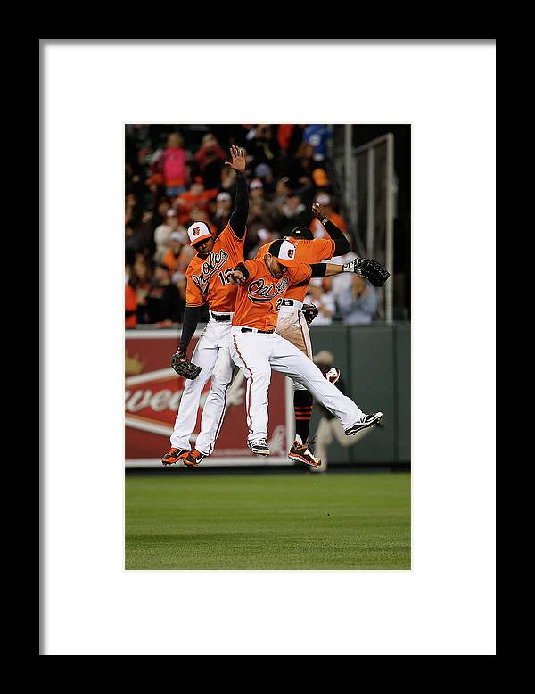 Following Framed Print featuring the photograph Alejandro De Aza, Steve Pearce, and Adam Jones by Rob Carr