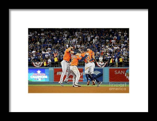 Alex Bregman Framed Print featuring the photograph Alex Bregman and Carlos Correa by Ezra Shaw