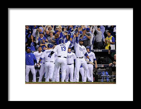 Salvador Perez Diaz Framed Print featuring the photograph Alex Gordon and Alcides Escobar by Ed Zurga