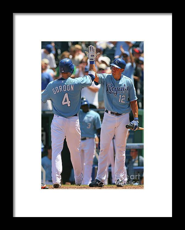 American League Baseball Framed Print featuring the photograph Alex Gordon and Mitch Maier by Tim Umphrey