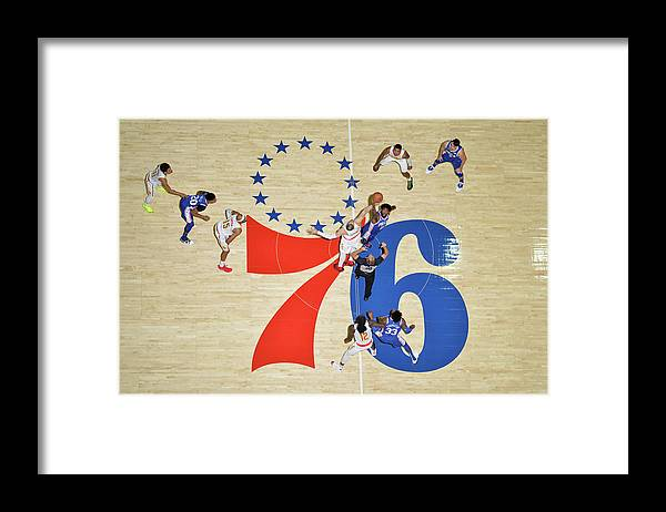 Nba Pro Basketball Framed Print featuring the photograph Alex Len and Joel Embiid by Jesse D. Garrabrant