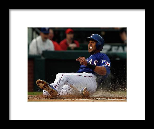 Second Inning Framed Print featuring the photograph Alex Rios and Michael Mckenry by Tom Pennington
