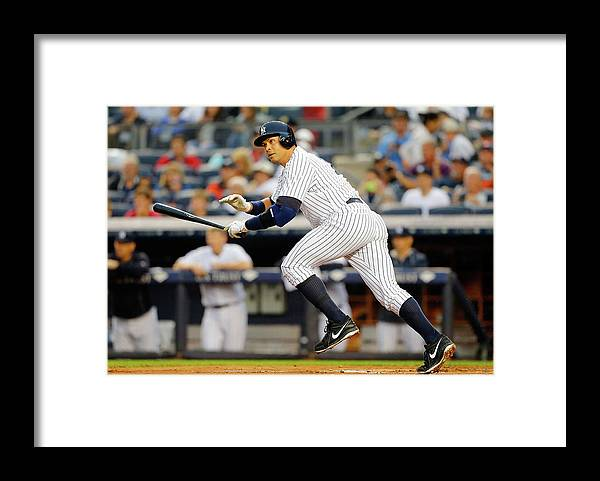 Following Framed Print featuring the photograph Alex Rodriguez by Jim Mcisaac