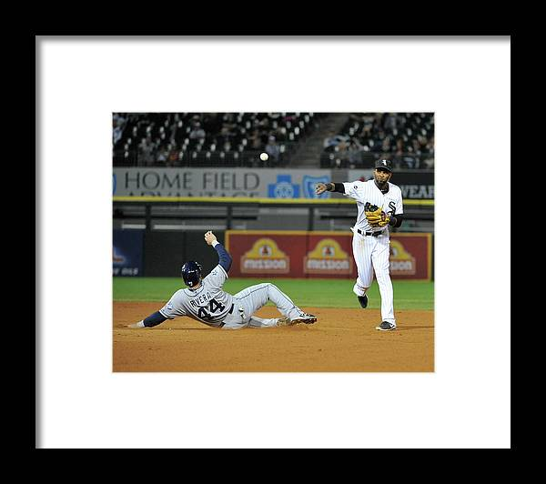 Ninth Inning Framed Print featuring the photograph Alexei Ramirez and Rene Rivera by David Banks