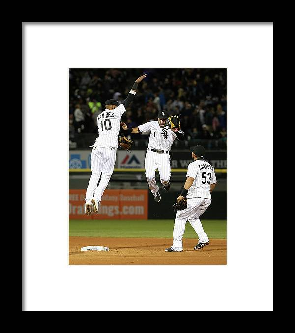 People Framed Print featuring the photograph Alexei Ramirez, Melky Cabrera, and Adam Eaton by Jonathan Daniel