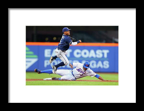 Double Play Framed Print featuring the photograph Alexi Amarista and Curtis Granderson by Mike Stobe