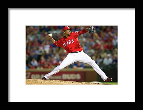 American League Baseball Framed Print featuring the photograph Alexi Ogando by Cooper Neill