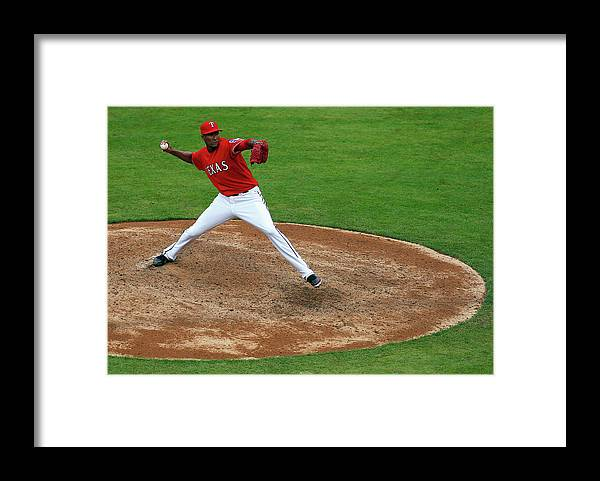 American League Baseball Framed Print featuring the photograph Alexi Ogando by Tom Pennington