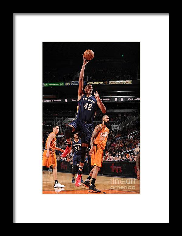 Nba Pro Basketball Framed Print featuring the photograph Alexis Ajinca by Barry Gossage