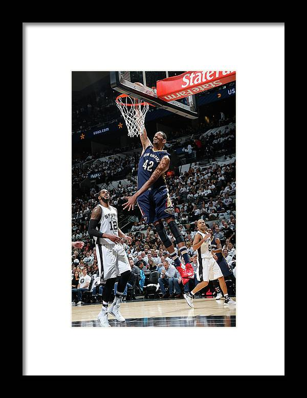 Nba Pro Basketball Framed Print featuring the photograph Alexis Ajinca by Chris Covatta
