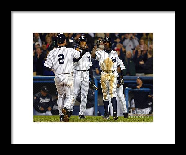 Alfonso Soriano Framed Print featuring the photograph Alfonso Soriano, Derek Jeter, and Bernie Williams by Al Bello