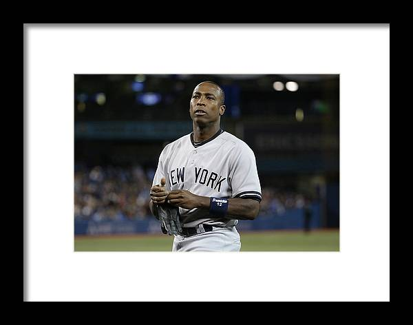 Alfonso Soriano Framed Print featuring the photograph Alfonso Soriano by Tom Szczerbowski
