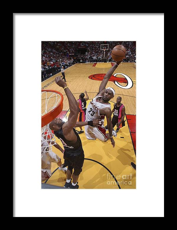 Nba Pro Basketball Framed Print featuring the photograph Alonzo Mourning and Lebron James by Andrew D. Bernstein