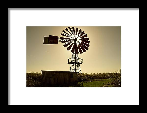 Outdoors Framed Print featuring the photograph American-style windmill in backlight by Bernd Schunack