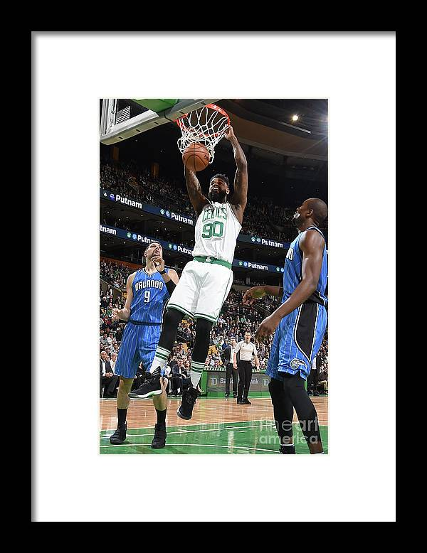 Nba Pro Basketball Framed Print featuring the photograph Amir Johnson by Steve Babineau