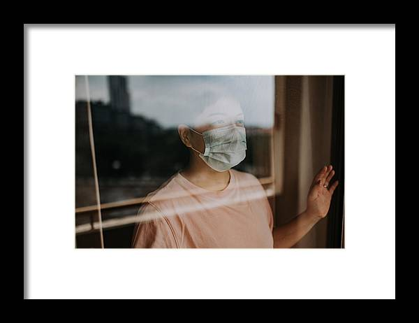 Cold And Flu Framed Print featuring the photograph An Asian Chinese Female Looking Thru Her Balcony Window With Her Face Mask During The Restricted Movement Order In Malaysia by Chee Gin Tan